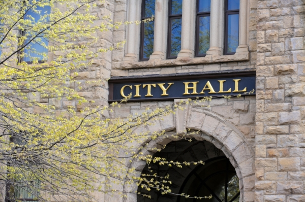 City Hall building entrance, older cut yellow sandstone structure, Johnstown, PA, USA.